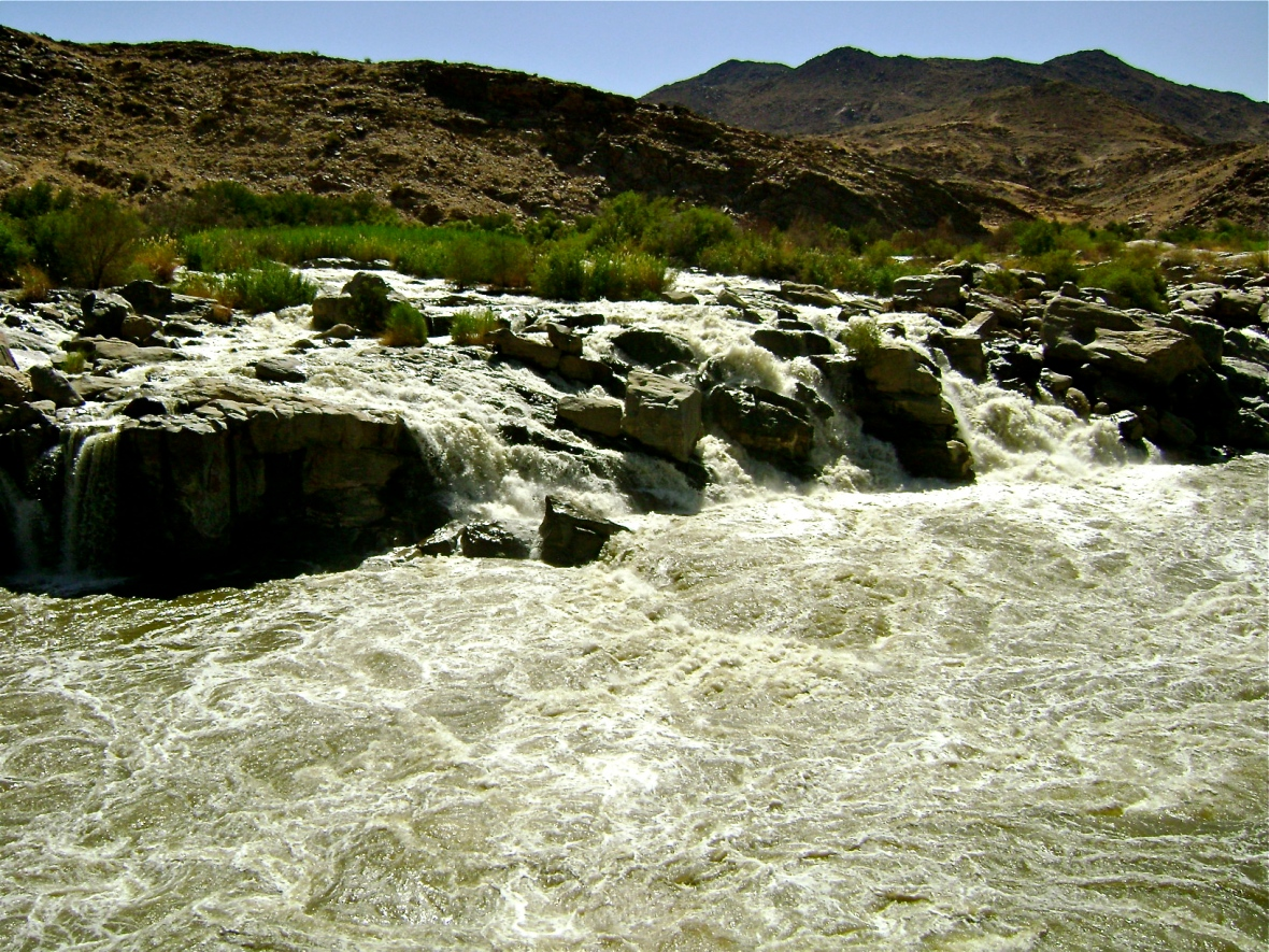 Water rushes over rocks on the Orange River.