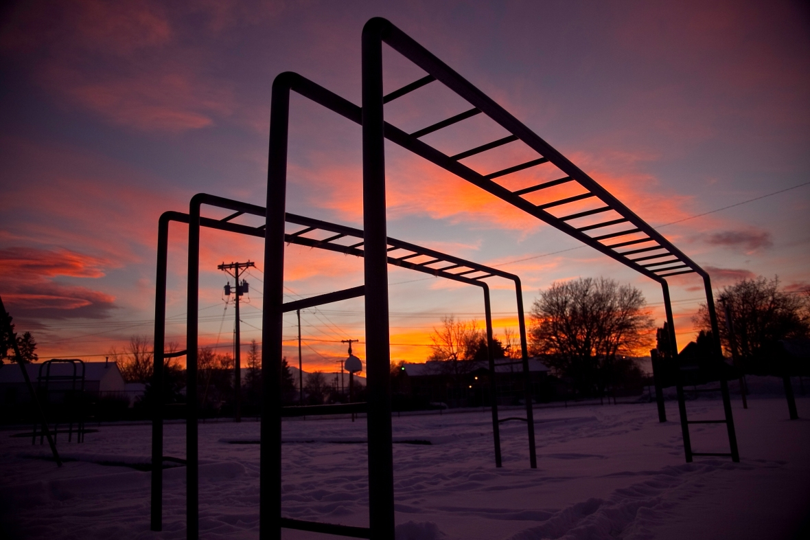 After a long day of interviews and romping and stomping around in the snow for photos, it is nice to come back and just goof around at the playground. There is something nostalgic about watching the sunset from the top of the monkey bars.