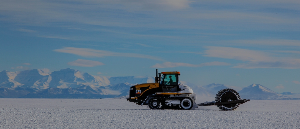 A Cat Challenger tracks across the Ross Ice Shelf in preparations for opening the Williams Field runway near McMurdo Station Antarctica.
